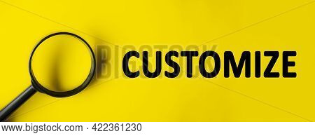 Text Customize Written Over Yellow Background. Magnifying Glass On Yellow Background. Minimal We Are
