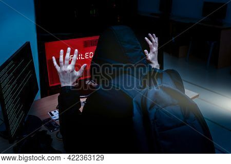 Internet Criminal Hacker Trying To Hack Into Corporate Servers Arrested By Police At Night. Portrait