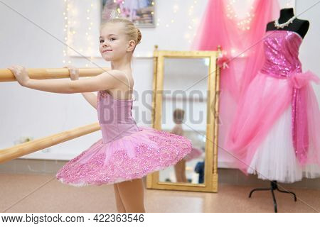 Little ballerina training. Children dance ?lassical ballet in studio.