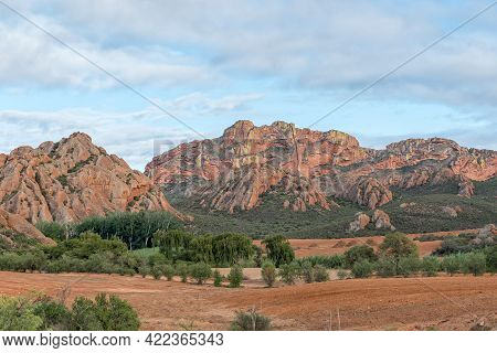 A Farm And Mountain Landscape At Red Stone Hills In The Western Cape Karoo