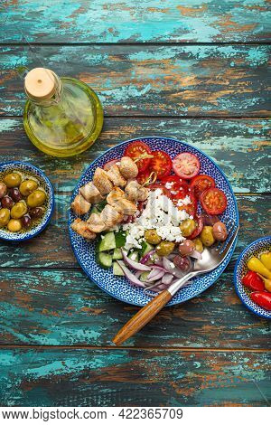Greek Meat Souvlaki And Mediterranean Salad With Vegetables, Feta Cheese On Plate On Rustic Wooden B