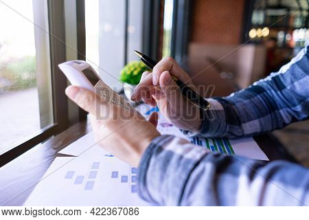 Businessman Or Bookkeeper Using Calculator Working In Finance And Accounting Analyze Financial Budge