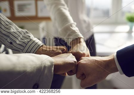 Closeup Hand Together Of Business Team Bumping Fist Jointing Standing In Office