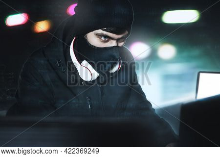 Angry Computer Hacker Weared Balaclava Stealing Data Via Pc From His Underground Hideoutin Front Of