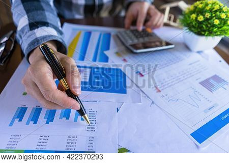 Bookkeeper Or Businessman Calculate And Pointing Income Of The Company Or Price Of The Product. Busi