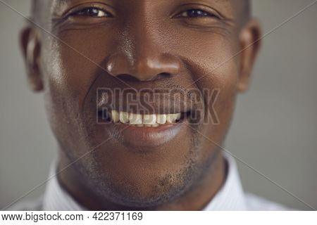 Closeup Portrait Of A Handsome Young African-american Man With A Happy Cheerful Smile