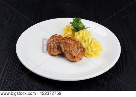 Chicken meat cutlet with mashed potatoes on white plate