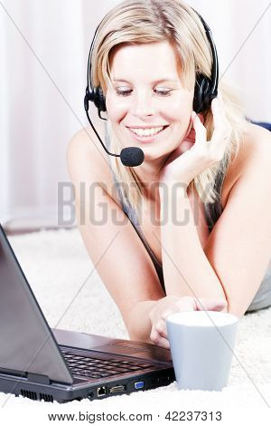 Blond Girl Talking On The Headset.