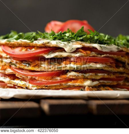 Zucchini Cake With Tomatoes. Stacked In Layers Zucchini Pancakes Decorated With Tomato And Mayonnais