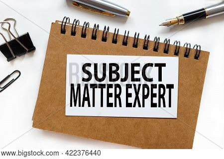Business Acronym Sme As Subject Matter Expert. The Inscription On The Business Card On The Notebook.