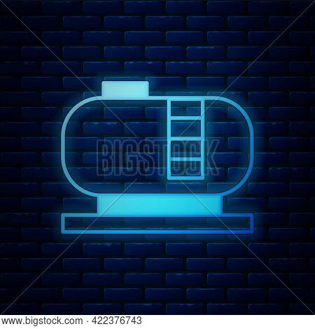 Glowing Neon Oil Tank Storage Icon Isolated On Brick Wall Background. Vessel Tank For Oil And Gas In