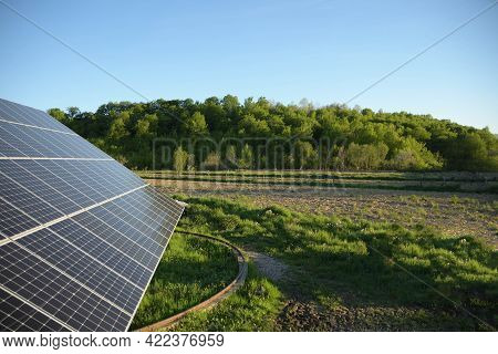 Solar Panel Against Blue Sky Background. Photovoltaic, Alternative Electricity Source. Idea For Sust