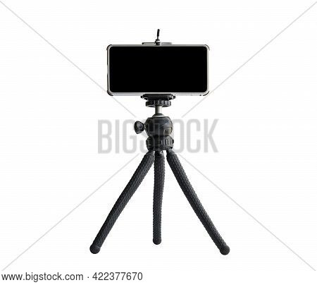 Smart Phone Isolated On Tripod In White Background. Blank Black Screen. Copy Space