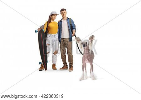 Male and female students with a longboard and a chinese crested dog isolated on white background