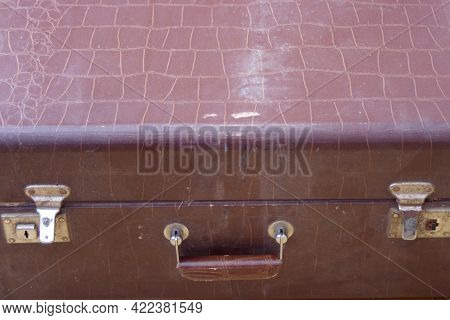 Close Up Of Old Metal Silver Fastener On A Large Vintage Brown Closed Suitcase
