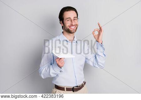Photo Portrait Businessman Wearing Formalwear Showing Okay Gesture Keeping Paper Plane Isolated Grey