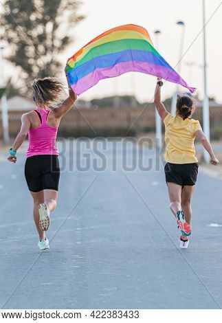 Girls Running With Lgbt Flag. Lgbt And Lesbian Couple Concept.