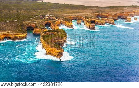 Scenic coastline. Australia, Port Campbell Park. Great Ocean Road and the Twelve Apostles is a group of limestone cliffs.  Picture taken from a helicopter