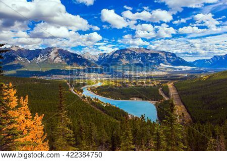 The azure water of the Kananaskis River in the mountain of Peter Lougheed Provincial Park. The autumn in the Canadian Rockies. The concept of active, ecological and photo tourism