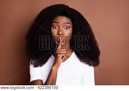Photo Of Young Afro Girl Cover Lips Fingers Shh Shut Up Keep Secret Conspiracy Isolated Over Brown C