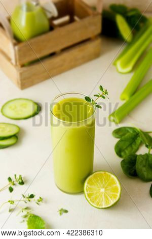Smoothie With Banana, Spinach, Lime. Healthy Detox Green Drink Glass