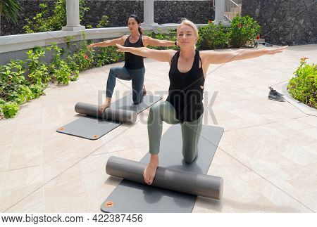 Two Beautiful And Happy Women In Sportswear With Smile Doing Stretching Exercises In Park On Sunny D