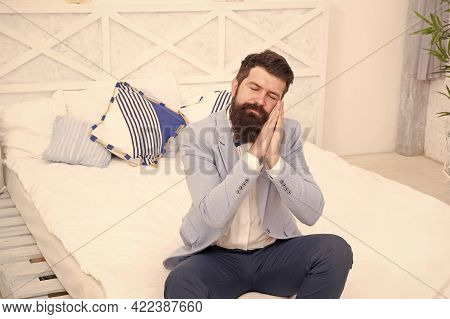 All Dressed Up And Nowhere To Go. Sleepy Hipster Sit On Bed. Bearded With Sleepy Look In Formalwear.