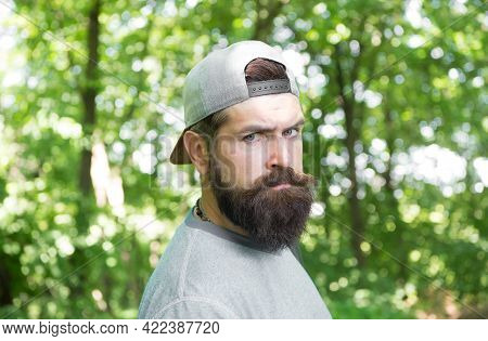 Mature Bearded Man In Cap. Summer Camping Vacation. Man Hipster Hiking. Male Beard Care. Brutal Hips