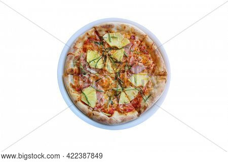 Hawaiian Pizza. A Ham and Pineapple Pizza on a white plate on a wooden table for lunch. Pizza is enjoyed world wide by hungry people. Pizza isolated on white.