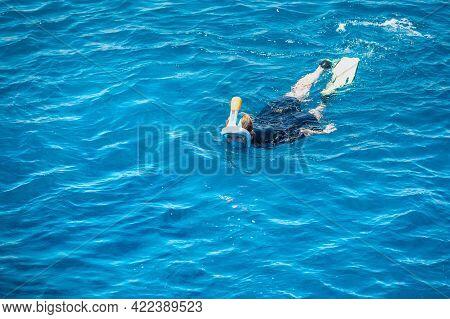 Snorkeling Concept. Woman Exploring Blue Sea While Snorkeling In Summer Day. Woman Snorkeling Swimmi