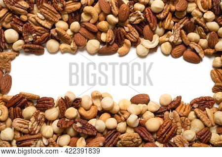 Mix Of Nuts Isolated On White Background. Top View.