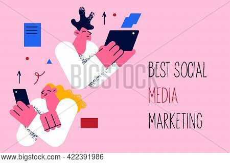 Best Social Media Marketing Business Concept. Young Positive Workers Holding Electronic Devices Look