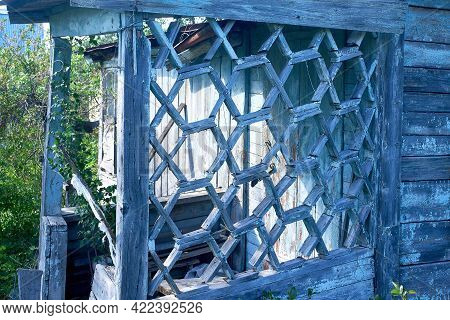 A Rickety Old Wooden Veranda Of An Abandoned House. Close-up