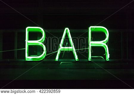 Close-up On A Green Neon Light Shaped Into The Word