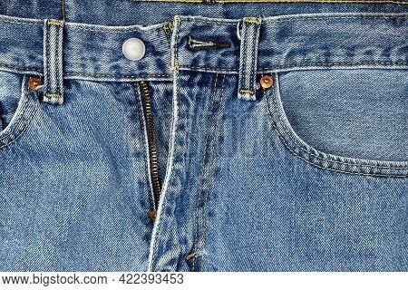 Close Up Of Unzipped Denim Blue Jeans