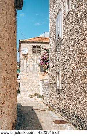 Empty narrow street in Trogir old town, Croatia.