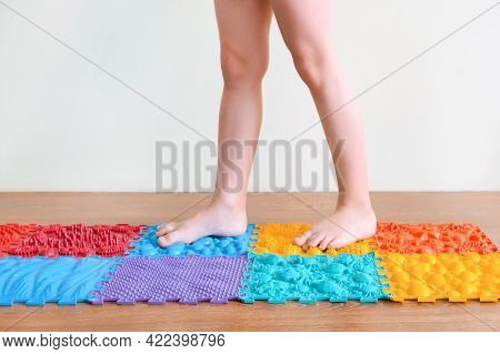 Foot Massage. Childrens Feet Walk On Orthopedic Mats. Treatment And Prevention Of Flat Feet And Leg