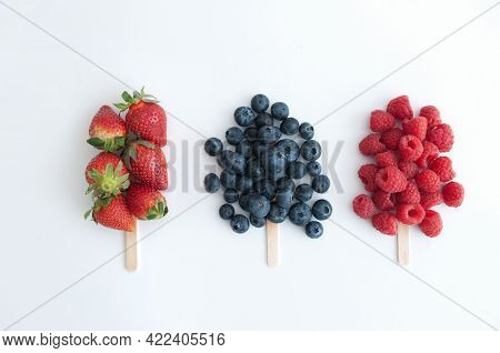 Fruit Berry Flavoured Ice Lolly Stick Concept, Strawberry, Blueberry And Raspberry