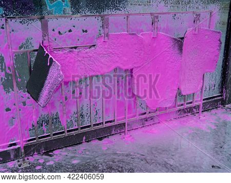 Covered Auto Mats With Pink Foam At A Self-service Car Wash. Car Wash With A Spray Of Magenta Soap F