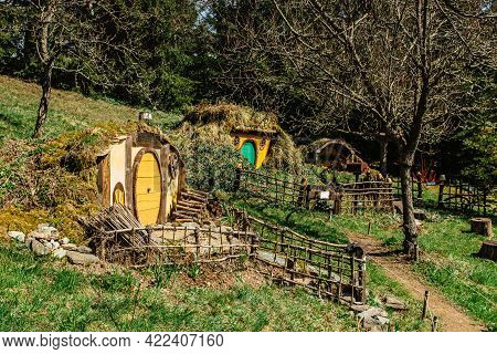 Hobbit House In Czech Hobbiton With Three Hobbit Holes And Cute Yellow Green Doors.fairy Tale Home I