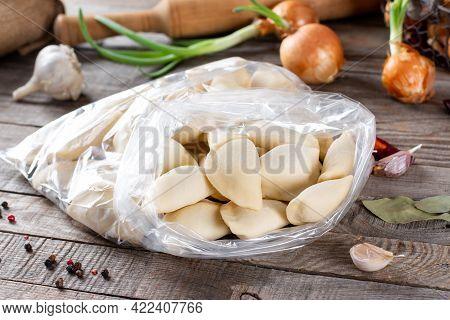 Frozen Dumplings. Dumplings With Minced Meat Sculpts Cook In The Kitchen. Prepare Homemade Dumplings