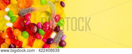 Candy Assorted Banner Copy Space. Candy Layout On A Yellow Background . Copy Space Candy. An Article