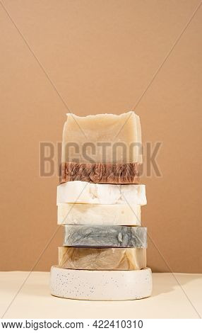 Tower Stack Of Different Handmade Soaps On Cream Background
