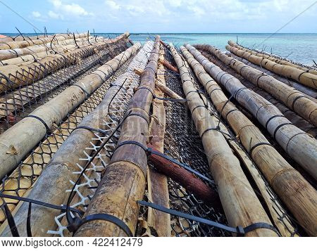 Perspective View Of Bamboo Trunks, Nets And Fishing Tackle. Traditional Antillean Fishing. Caribbean