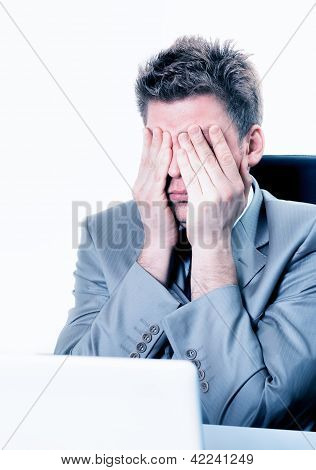 Overwhelmed Businessman At The Office