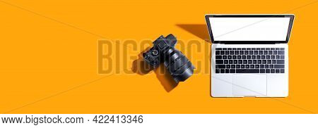 Laptop Computer With A Slr Camera From Above