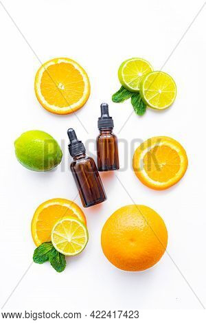 Cosmetic Oil And Citrus Fruits . Cosmetic Procedures. Healthy Skin. Skin Care. Citrus Oil. White Bac