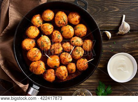 Bombay Potatoes. Pan Fried Little Baby Potatoes With Jeera Seeds And Coriander In Frying Pan Over Wo