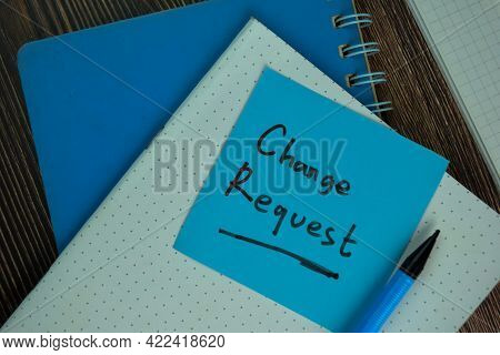 Change Request Write On Sticky Notes Isolated On Wooden Table.