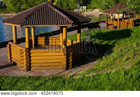 Wooden Gazebo For Relaxing On The Shore Of The Reservoir In The Park